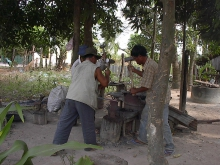 Men injured by landmines become blacksmiths