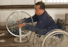 Amputee making a wheelchair.